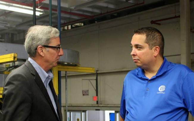 Paul Elio and Comau discuss the status of equipment sale.